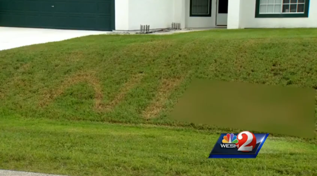 CREDIT: WESH A Florida man found a racial slur burned into his front yard.