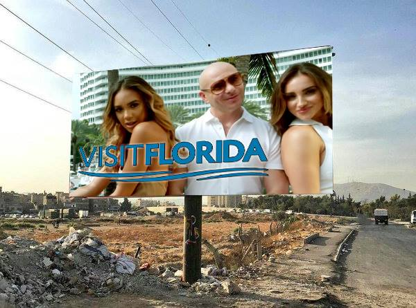 Satirical billboard of Pitbull / Visit Florida set in Syria