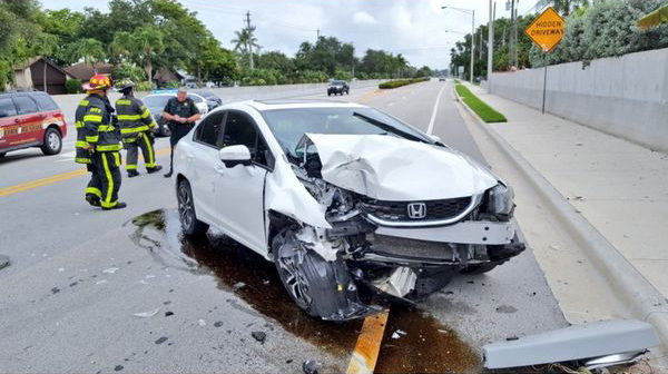 A 27-year-old Florida woman suffered only minor injuries when her car crashed into a pole Tuesday morning following a spider sighting.
