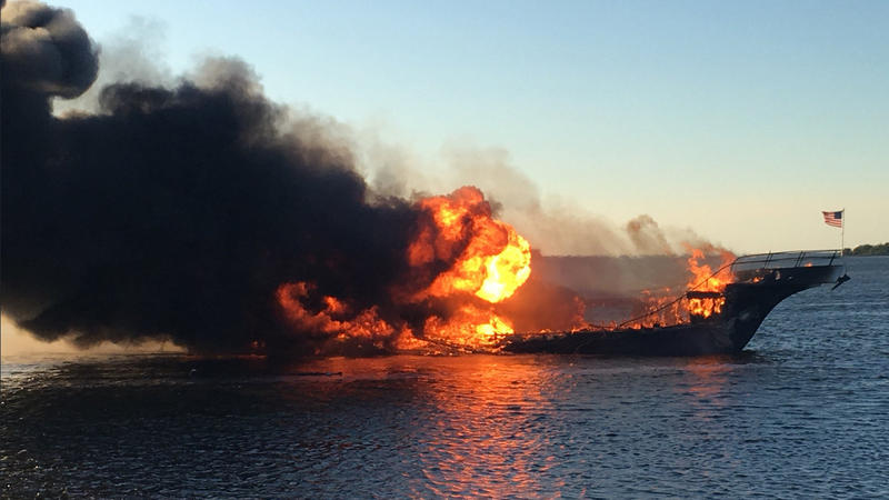 Flames engulf a casino shuttle boat Jan. 14, 2018, in the Tampa Bay area. The boat caught fire near the shore, and dozens of passengers and crew safely made it to land, authorities said.  (AP)